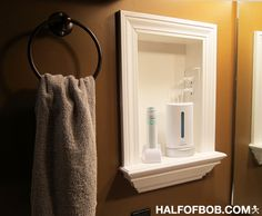 would like a niche with outlet to store electric toothbrush beside vanity, more minimalist style than this though