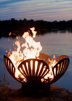 Unique, artistic shell-themed outdoor metal fire pit: Barefoot Beach Gas Firepit from Serenity Health. Ideal decor for beach houses, lakeside patio areas, nautical-themed design schemes and more.