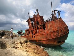 This is the Gallant Lady shipwreck on the north coast of Bimini in the Bahamas. She originally sailed out of Belize City and was grounded here during a storm. Abandoned Ships, Abandoned Buildings, Abandoned Places, Bad Storms, Rust In Peace, Belize City, Rocky Shore, Old Boats, World Geography