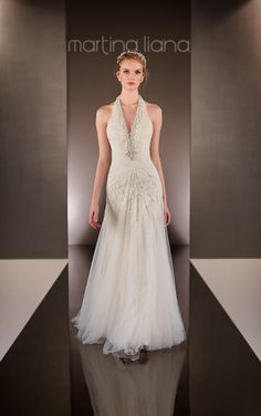 This heirloom quality Martina Liana Lace and Tulle over Parisian Silk Chiffon sheath bridal gown with a V-neckline features elegant Diamante beading on the halter.