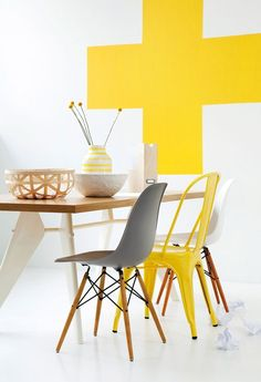 So into yellow for the home right now. Love the mismatched Eames style chairs in this shot too.