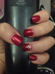 Red nails.  Like the simple accent on one nail.