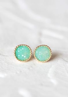 Perfect Paradise Stone Earrings 12.99 at shopruche.com. Perfect for adding a hint of light catching shimmer to your style, these  gold colored studs are polished with textured mint green accents.0.5""