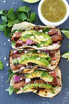 Grilled Steak Tacos Recipe Easy grilled steak tacos topped with avocado, red onion, cilantro, and queso fresco. These easy tacos are a favorite summer meal. Grilled Steak Recipes, Grilled Meat, Grilling Recipes, Beef Recipes, Grilled Steaks, Vegetarian Grilling, Grilling Ideas, Healthy Grilling, Barbecue Recipes