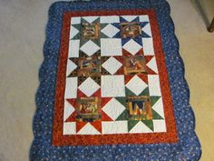 Christmas lap quilt.  The Nativity scene fabric is just beautiful.  Peace, Robert from nancysfabrics.com