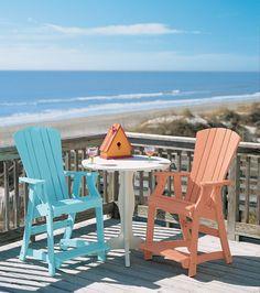 Colorful Adirondack Chairs On Beach