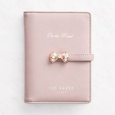 Ted Baker travel wallet is perfect for on-the-go girls! Feminine floral interior holds all your cards and cash. Bow detail enclosure holds it all together.<br><br> Size - 4 x 6