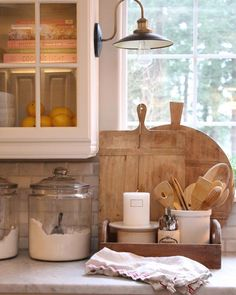 We both love old cutting boards and large glass crocks for flour, sugar, etc. in the kitchen.