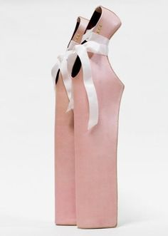 Pink ballet inspired high heal platform shoe. I get dizzy looking at it. :P that would be horrible to have to walk around all day two foot taller than u actually are, AND point your toes. :P (what if u fell over, that's a long way down and HOW IN THE WORLD would u stand up???)