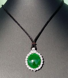 Imperial Green Jadeite Jade Diamond Pendant Lot 121 EST Price: USD 40,000 - 60,000 Start Price: USD 20,000 Diamond Pendant, Jade, Auction