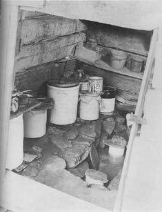 Great Smoky Mountains NP: Walker Sisters Home — interior of the spring house. The crocks probably held milk, cream, butter and other items to keep them as cool as possible in the summer.