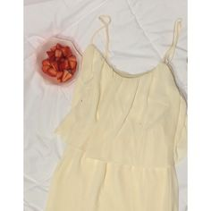 F21 Cream Flowy Dress This cream colored dress has been worn 1x in NYC during summer 2014. The straps are adjustable. There's more than one layer, making it perfect for spring. It can be paired with almost anything. It's apart of Forever 21 Contemporary brand. It's super flowy and comfortable. If you have anymore questions feel free to ask! Pictures: The color differs in lighting, but it's a cream color. I showed a photo of it laying flat in bright light and hanging up with a little…