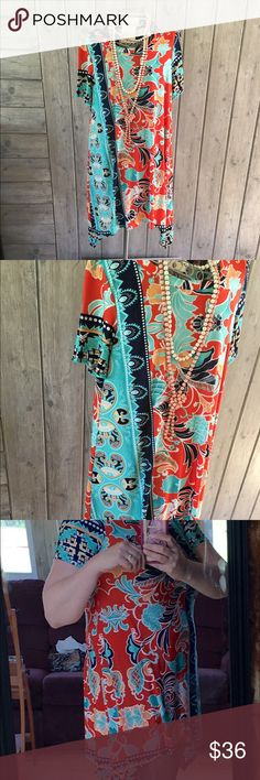 Tunic print with different lengths hem. Tunic to shorter dress with different length hem. Geo print to paisley print. Very cute. Made in USA. With poly/spandex. Boutique  Tops Tunics