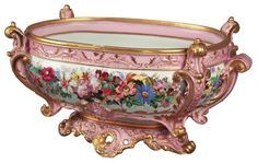 *DRESDEN VOLTSTEDT:    Centerpiece, porcelain, pink ground w/ gold overlay decorations in oval form, 16 w x 9.5h x 7.5 wide, made in Thuringa, Germany, Company started by: Entrepreneur: Gweorge Heinrich Macheleid, in 1760.