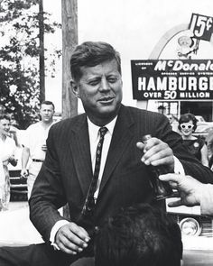 JFK in Partick opening a precursor to McDonald's at Partick Subway station.