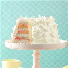 Rainbow Sherbet Angel Food Cake Recipe -Talk about a dessert that pops. Sometimes, I make this easy cake even more eye-catching by coloring the whipped cream, too. Use whatever sherbet flavor combination you like. —Bonnie Hawkins, Elkhorn, Wisconsin