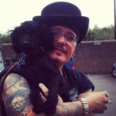 Adam Ant takes a quick break outside and takes Boo the studio dog with him.