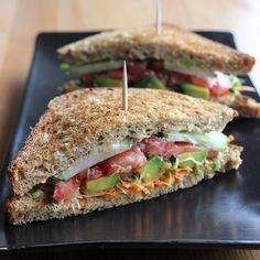 Veggie and Hummus Sandwich  INGREDIENTS  2 slices of sprouted whole-grain bread 2 tablespoons hummus 3 thin slices of cucumber 2 thin slices of tomato 3 slices of avocado 1/4 cup alfalfa sprouts 1/4 cup grated carrots  DIRECTIONS  Toast your bread. Spread one tablespoon of hummus on each slice of bread, layer up your veggies, and enjoy!  Source: http://www.popsugar.com
