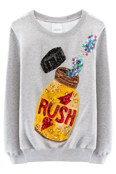 """ASHISHRUSH SWEATSHIRT Grey crewneck sweatshirt withappliquédsequin poppers motifon front. Unisex. Made in India. 65% Cotton / 35% Polyester. ASHISH AshishGupta likes sequins.... like, a lot. Since appearing on the London fashion scene in 2011,Ashishhas carved out his place as the """"King Of Sequins.""""Pieces are handcrafted and manufactured in-house in India."""