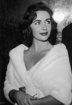 "Elizabeth Taylor at a party for the opening of John Huston's film ""Moby Dick"" at the Mocambo nightclub, 1956"
