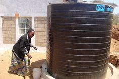 Water tanks, like this one in #Kenya, allow people to collect water when it rains or when municipal water is turned on.