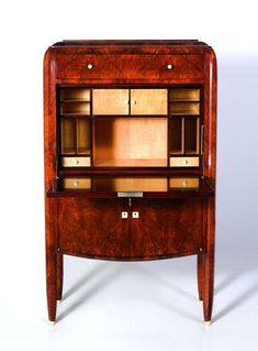 Fine Art Deco Drop Front Secretary by Jules Leleu , ca. 1928, materials: Walnut, lacquered wood, ivory, sycamore