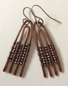 Hammered modern copper earrings with silver beads - wire wrapped via Etsy