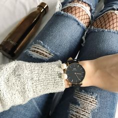 Daniel Wellington watch, swell bottle, ripped jeans, fishnet tights