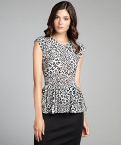 style #322028801 grey and white leopard print stretch jersey peplum top.  Rrrraawwwrr!!
