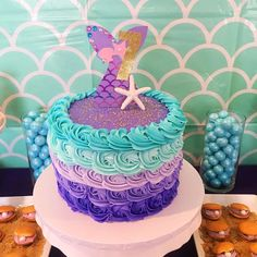 The birthday cake is at this Mermaid  Birthday Party is stunning!! See more party ideas and share yours at CatchMyParty.com #mermaid #cake