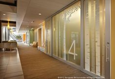 """In lieu of large waiting rooms, the Everett Clinic Smokey Point Medical Center features """"pause areas"""" located directly adjacent to patient care pods, reducing the overall plan size."""