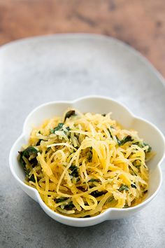 Spaghetti squash roasted first then shredded and sautéed with chard and Parmesan. Great veggie side! On