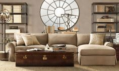 small sectional with a steamer trunk coffee table