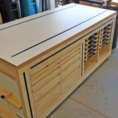 Multi-Function Workbench by Russ- Multi-Function Workbench by Russ Amazing version of my workbench by Russ Prince, he has made some interesting changes such as using t-track guides to hold pieces and placing a long power strip in the front of the bench. Workbench With Drawers, Workbench Plans Diy, Workbench Designs, Woodworking Bench Plans, Woodworking Workshop, Woodworking Projects, Woodworking Assembly Table, Woodworking Files, Green Woodworking