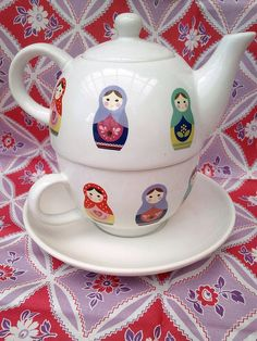 Russian Dolls tea for one teaset (stacking teapot, cup and saucer) ... decorated with Russian matryoshka nesting doll images in variety of bright colours, ceramic