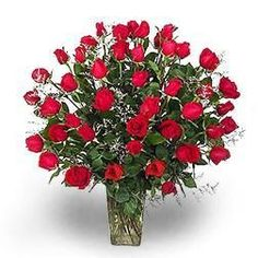 """""""Red Roses - 4 dozen."""" 48 Hand selected red roses vased with assorted greens & filler. Stunning!"""