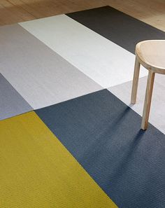 Woodnotes' carpets, manufactured from woven paper yarn, are indisputable classics of Finnish design. Fourways is a modern carpet designed by Ritva Puotila, where the richly colored wide stripes run all through the carpet.