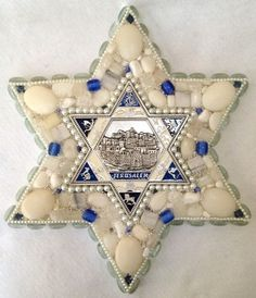 Small star of David by Shannon D Designs. This wall art is embellished with semi-precious gemstones. The center magen David is from Jerusalem and has a relief of the Jerusalem in the center.