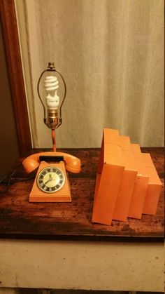 Cool Check this Vintage Mid-Century Telephone Desk Lamp So cute! and vintage. The Trea-Boye Corp. Made of cast iron . Vintage Lamps, Vintage Lighting, Island Pendant Lights, Furniture Fix, Table Lamps For Bedroom, Orange Phone, Stained Glass Designs, Tiffany Lamps, Unique Lamps