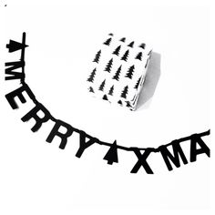 merry Xmas banner and black and white wrapping paper