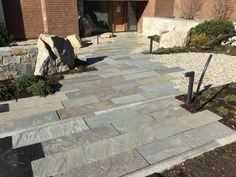 Full color natural cleft bluestone/full color walkway, laid in a horizontal pattern.  Great to lead you up to the main entrance.