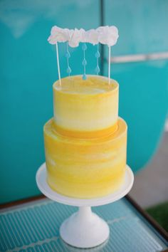 A gorgeous yellow wedding cake, with a painted effect.