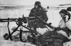 """Men of the Waffen SS """"Totenkopf"""" Division man a MG 34 in the open steppe, Note the two troops casually strolling in the right background Mg 34, German Soldiers Ww2, German Army, Military Photos, Military History, Luftwaffe, M1 Garand, Germany Ww2, Munich Germany"""