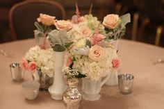vintage milk glass collection with blush wedding flowers for reception centerpiece by AntebellumDesign.com