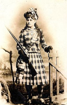 Annie Oakley in her specially made tartan outfit 1891