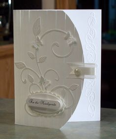 handmade card Elegant Wedding Card by WhimsyArtCards ... all white ... die cut leafy flourish ... arched border on front reaveals part of the back .... nice design detal ... great card!
