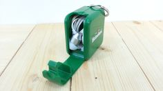 Cubic shape - multiple function keychain holder (earpiece storage holder and phone stand)