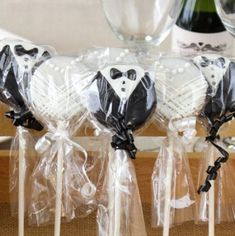 Oreo lollipops dressed up for the wedding as the happy couple.  See more Oreo cookie favors and party ideas at www.one-stop-party-ideas.com