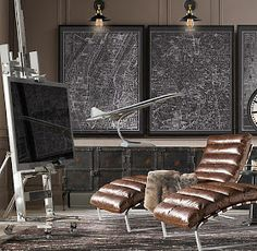 Those maps would be an easy DIY. Spray adhesive and spray lacquer to secure the prints to the board. The effect is cool for a bachelor pad or a man cave. Web Design, House Design, Graphic Design, Curved Tvs, Vintage Industrial Decor, Decor Vintage, Industrial Interiors, Industrial Office, Industrial Lighting