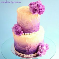 Video tutorial for the airbrished technique can be found at: http://www.youtube.com/rosiesdessertspotaustralia . A two  tier airbrushed rustic garden cake. Wow that was a mouthful. A 4 inch sitting on top of a 6 inch, flavoured chocolate chip vanilla sponge with a chocolate custard filling. Decorated with fresh purple carnations. What can't you do with an airbrush? My favourite cake decorating tool I think. The messy buttercream frosting is also growing on me. It never used to, but I think…